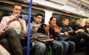 1414458222875_wps_21_Passengers_using_mobile_p